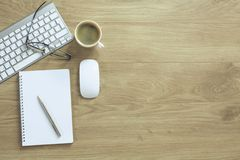 A cup of coffee on the office table royalty free stock photo