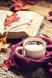 Cup of coffee old book glasses and autumn leaves. Royalty Free Stock Photo