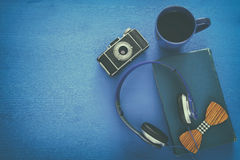 cup of coffee, old book, vintage photo camera and headphones Stock Photography