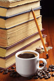 Cup of coffee and old books Stock Photography