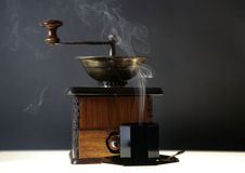 Cup of coffee and old coffee grinder Royalty Free Stock Images
