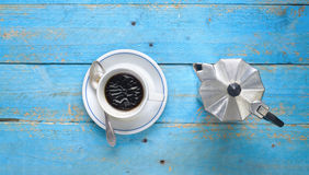 Cup of coffee and old coffee maker Royalty Free Stock Images