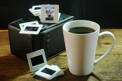 Cup of coffee and old film slides of art and culture memories Royalty Free Stock Photo