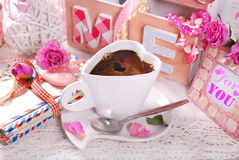 Cup of coffee and old love letters in romantic scenery Stock Photos