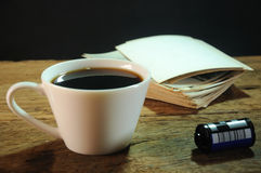 Cup of coffee and old paper photo frame on wood background. Cup of coffee, film and old paper photo frame on wood background Royalty Free Stock Image