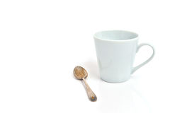 Cup of coffee with an old silver Royalty Free Stock Photography