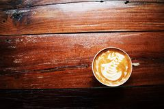 A cup of coffee on the old wooden table. Coffee shop, Thailand. royalty free stock images