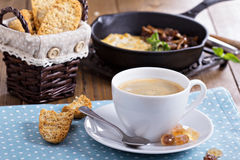 Cup of coffee with omelette for breakfast Royalty Free Stock Images