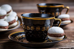 Cup of coffee and one little macaroon Royalty Free Stock Photo