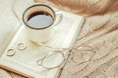 Cup of coffee and open book stock image