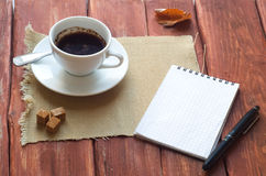 Cup Of Coffee and Open notebook Stock Photos