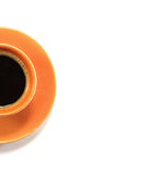 Cup of coffee. Orange cup of cofee with saucer Royalty Free Stock Images