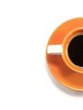 Cup of coffee. Orange cup of cofee with saucer Royalty Free Stock Photo