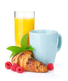 Cup of coffee, orange juice and fresh croissant Royalty Free Stock Image