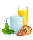 Cup of coffee, orange juice and fresh croissant Stock Images