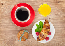 Cup of coffee, orange juice and fresh croissant Royalty Free Stock Images