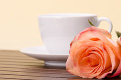 Cup of coffee and orange rose Royalty Free Stock Photography