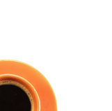 Cup of coffee. Orange cup of coffee with saucer Stock Photo