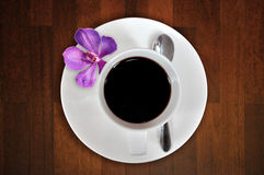 Cup Of Coffee With Orchid Stock Image