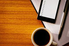 Cup of Coffee with Organizational Tools on Desk Royalty Free Stock Images