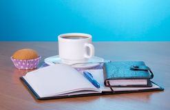 Cup of coffee and organizer with a ball pen Royalty Free Stock Photos
