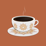 Cup of coffee with ornate eastern round elements Royalty Free Stock Photo