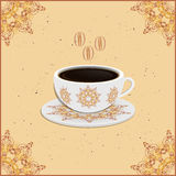 Cup of coffee with ornate eastern round elements Stock Images