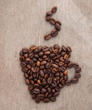 Cup of coffee out of coffee beans Royalty Free Stock Photos