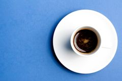 Cup of coffee over the blue Royalty Free Stock Image