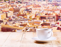 Cup of coffee over cityscape Stock Image