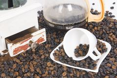 Cup of coffee over coffee grain with coffee pot Stock Photography