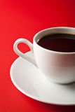 Cup of coffee over red Royalty Free Stock Image