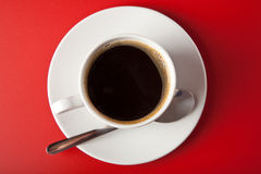Cup of coffee over red Stock Image