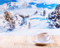 Cup of coffee over winter landscape Stock Images