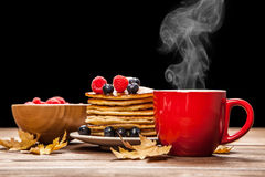 Cup of coffee and pancakes Royalty Free Stock Images