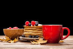Cup of coffee and pancakes Royalty Free Stock Photo