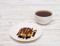 Cup of coffee and pancakes Stock Images
