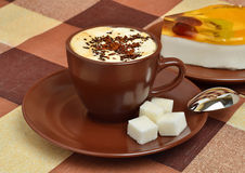 The cup of coffee and the panna cotta on the plate Stock Image