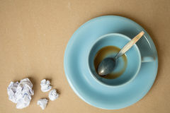 Cup of coffee and paper ball on wood background. Cup of coffee and paper ball Royalty Free Stock Photo
