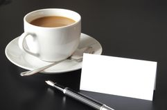 Cup of coffee and paper copyspace Royalty Free Stock Photos