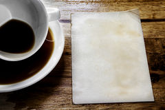 Cup of coffee with paper Royalty Free Stock Photos