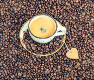 Cup of coffee with paper heart. Love concept. Vintage toned Stock Photos