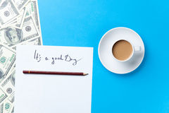 Cup of coffee and paper with inscription and dollars Royalty Free Stock Photography