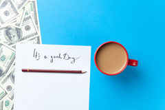 Cup of coffee and paper with inscription and dollars Stock Photo