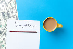 Cup of coffee and paper with inscription and dollars Stock Photos