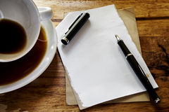 Cup of coffee,paper and pen Royalty Free Stock Photos