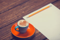 Cup of coffee and paper Royalty Free Stock Photos