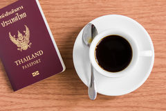 Cup of coffee. Coffee cup with passport on table royalty free stock photo