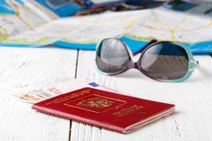 Cup of coffee, passports and no name boarding passes. Traveling concept royalty free stock photos