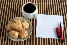 Cup of coffee and pastries and with blank paper stock photos